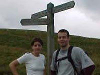 Walkers at Waymarker where the St Cuthbert's Way leaves the Pennine Way